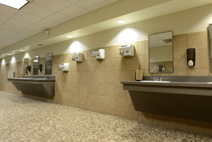washroom with multiple hand dryers